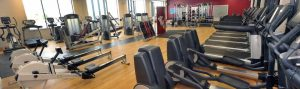 Gym equipement and exercise machines in a brightly lit room